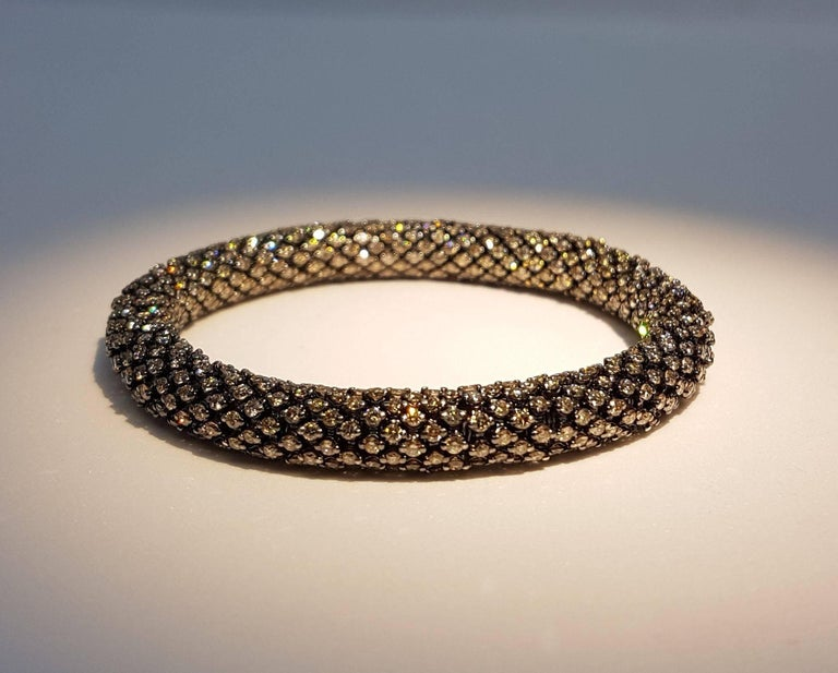 Exceptional brown diamond and white gold bracelet. The bracelet is very flexible and therefore adapts to different wrist sizes. Total weight of diamonds: 25.80 carats. Chic and sporty at the same time! Different models available!