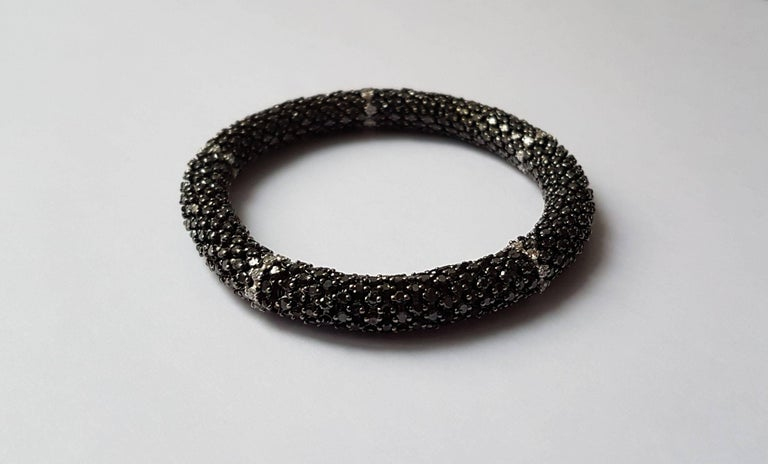 Amazing black diamond and white gold bracelet. The bracelet is very flexible and therefore adapts to different wrist sizes. Total weight of diamonds: 22 carats. Chic and sporty at the same time! Different models available!