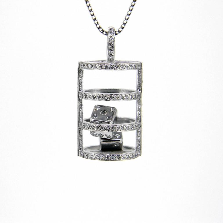 The thrill of the roll of a dice can go with you everyday with this beautiful 18ct white gold pendant designed and handmade by us here at Imp Jewellery, Melbourne.   A diamond-set cage holds two diamond-set dice that roll around freely.  The cage