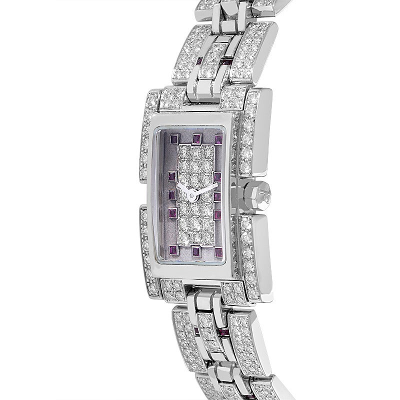 Fred lady's 18k white gold, diamond and ruby bracelet watch, quartz movement, ~5.65 cts of diamonds and ~1.40 cts of rubies.  Case Width:18 mm