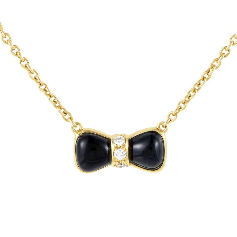 Van Cleef & Arpels Onyx Diamond Gold Bow Pendant Necklace
