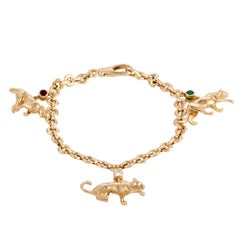 Cartier Panthere Diamond Ruby and Emerald Yellow Gold Panther Charm Bracelet
