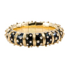 Tiffany & Co. Schlumberger Diamond and Onyx Yellow Gold Bombe Bangle Bracelet