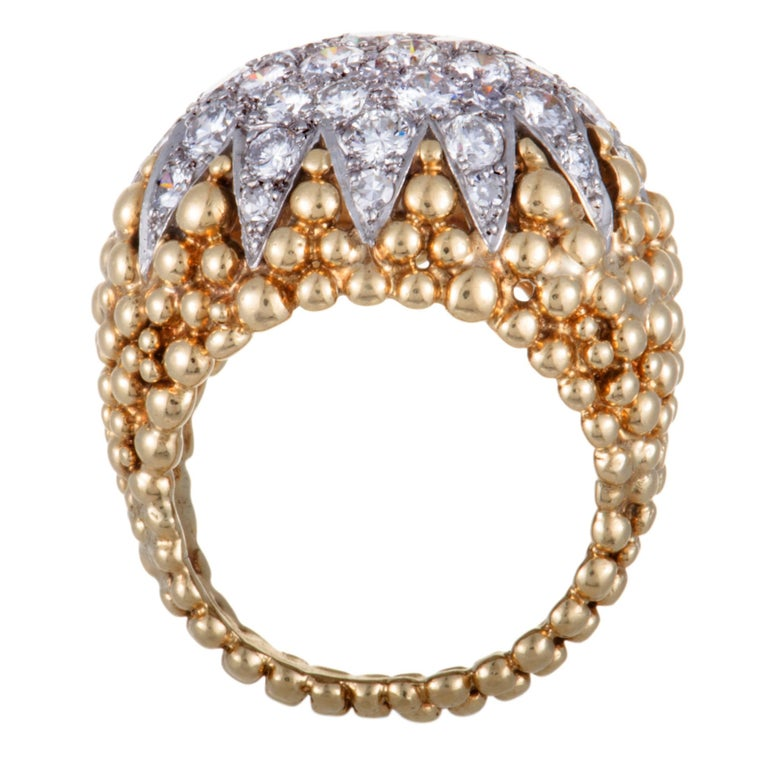 If you wish to accentuate your look with a jewelry piece that exudes luxurious prestige and refined extravagance then this fabulous David Webb ring is a perfect choice. The ring is made of 18K yellow and platinum and it is expertly set with