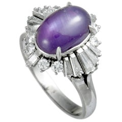 Round and Tapered Baguette Diamonds and Purple Sapphire Cabochon Platinum Ring