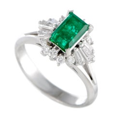Round and Tapered Baguette Diamonds and Rectangle Emerald Small Platinum Ring