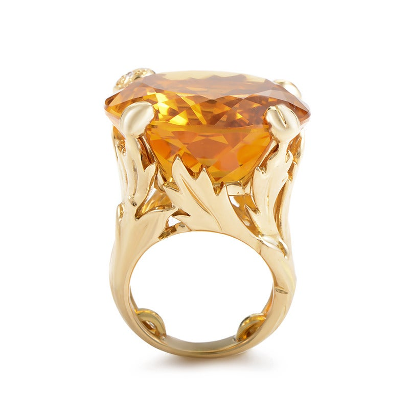 This delightful, harmoniously designed Dior ring is impeccably crafted from attractive 18K yellow gold and features a remarkable citrine center stone subtly accented with diamonds.  Included Items: Manufacturer's Box Ring Size: 3.25 (44 5/8)
