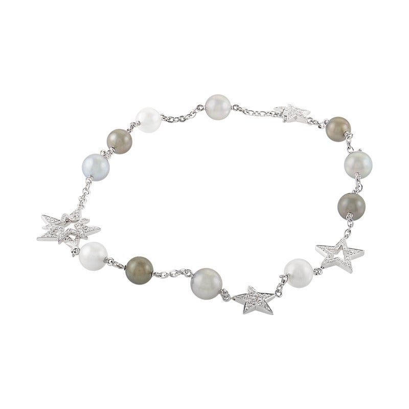 Shine as bright as the stars as you don this dazzling necklace from Chanel. The necklace from the Perles et Etoiles collection is made of 18K white gold and boasts a design accented with three South Sea and eight Tahitian pearls as well as
