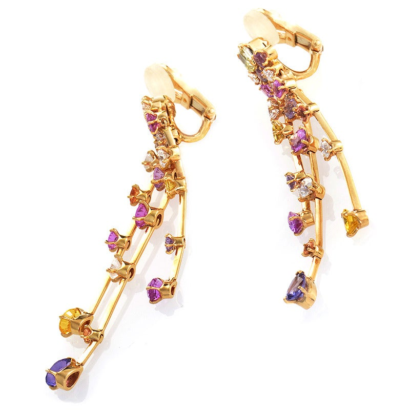 A heavenly design from one of the world's foremost brands, this pair of earrings from Chanel are true show-stoppers! Made of 18K rose gold the main attraction of this pair of earring's design is the colorful cascade of gemstones.