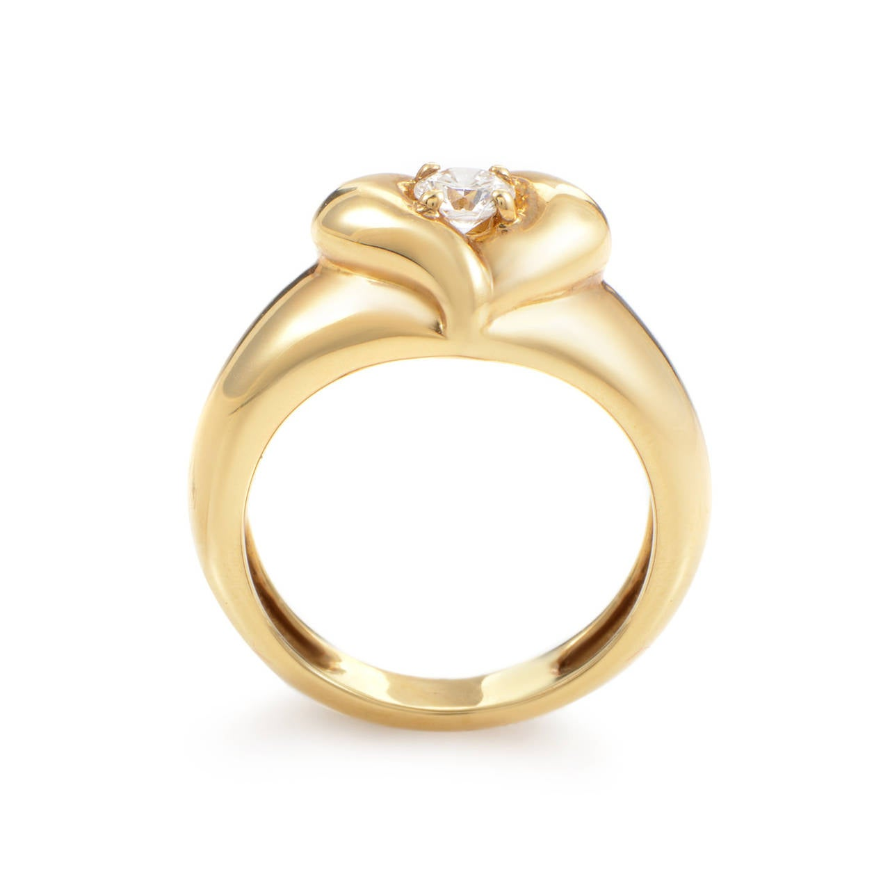 This Van Cleef & Arpels ring boasts a romantic design that is sure to steal your heart. The ring is made of 18K yellow gold and boasts a heart-shaped motif which holds a single, .25 carat white diamond. Ring Size: 4.75 (48 3/8)