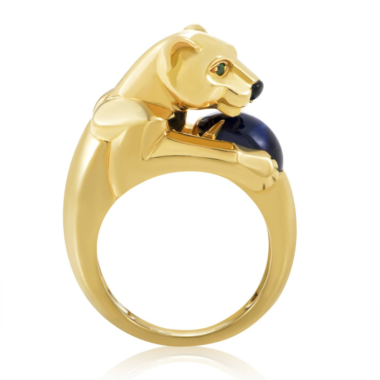 A brilliant blue sapphire is the hallmark of this dazzling creation from Cartier's Panthere collection. The ring is made of 18K yellow gold and boasts a panther-shaped motif with green emerald eyes, an onyx nose, and a sapphire stone clutched in its