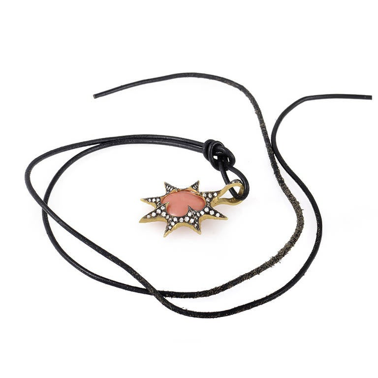 The lady who enjoys fine jewelry that is still wonderful for everyday wear will love this brilliant necklace from Cathy Waterman. The necklace is a black leather cord from which hangs a 22K yellow gold, rhodium-treated pendant. The pendant is set