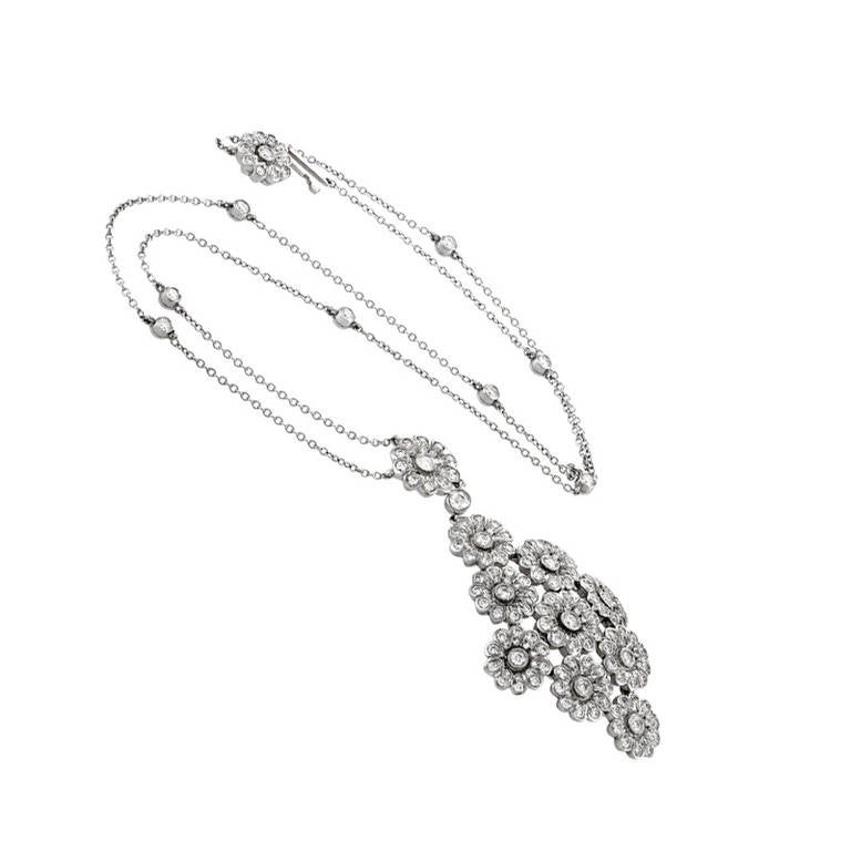 This pendant necklace from Tiffany & Co. is truly amazing with its gorgeous diamond-set design. The necklace chain is a platinum Diamonds by the Yard chain from which hangs a platinum pendant. The pendant is also made of platinum and is comprised of