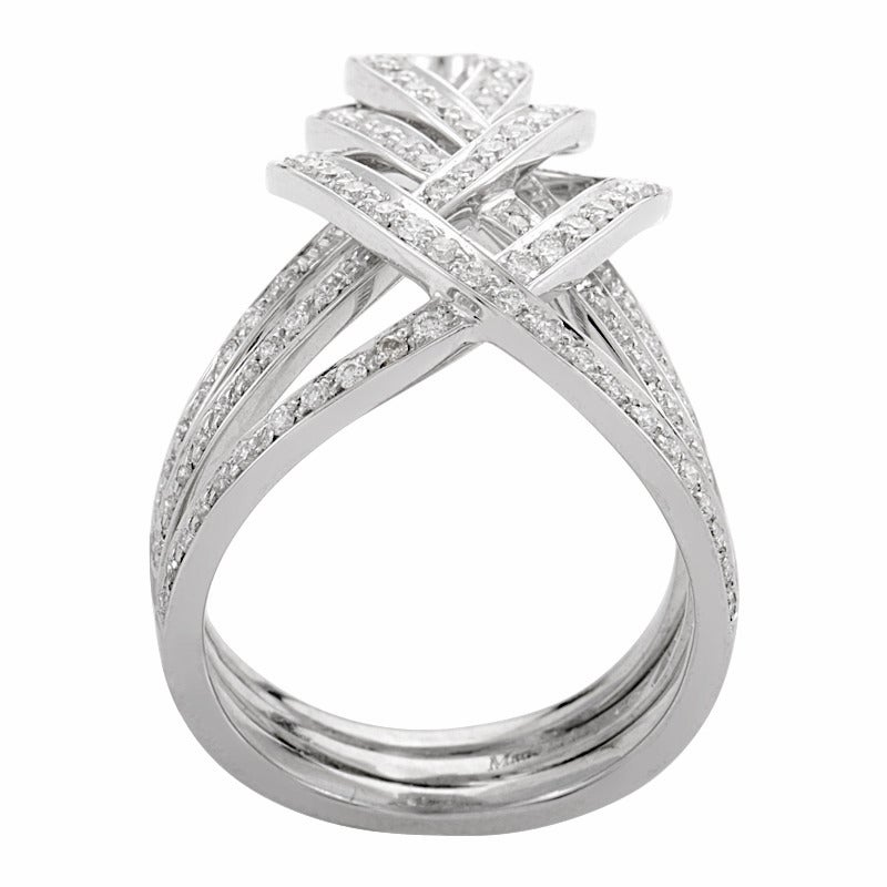 The woven design of this band ring from Damiani is sure to captivate with its divinely lavish look. The ring is made of 18K white gold and is set with ~.67ct of  gorgeous white diamonds.