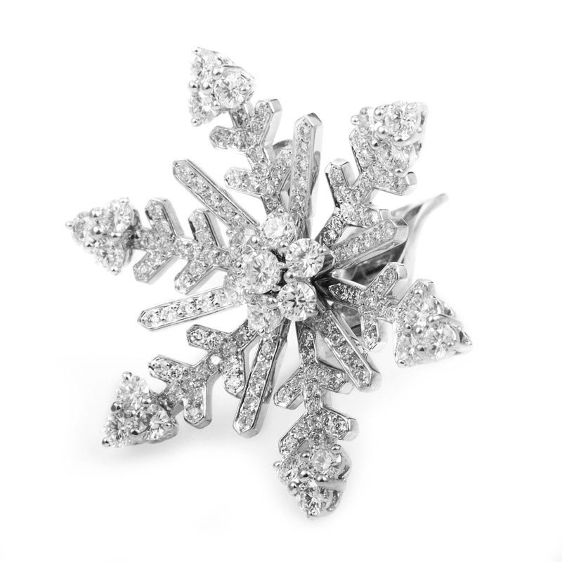 Intricately designed and dazzling to behold, this pair of earrings from Van Cleef & Arpels are inspired by the beauty of the winter season. The earrings are made of 18K white gold and are shaped to look like delicate snowflakes dusted with