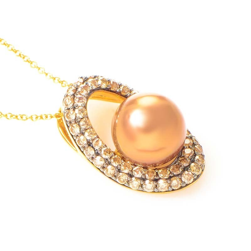 This pendant necklace from LeVian is refined and gorgeous. It is made of 14K yellow gold and boasts a lustrous brown pearl accented with ~1.05ct of champagne diamonds.