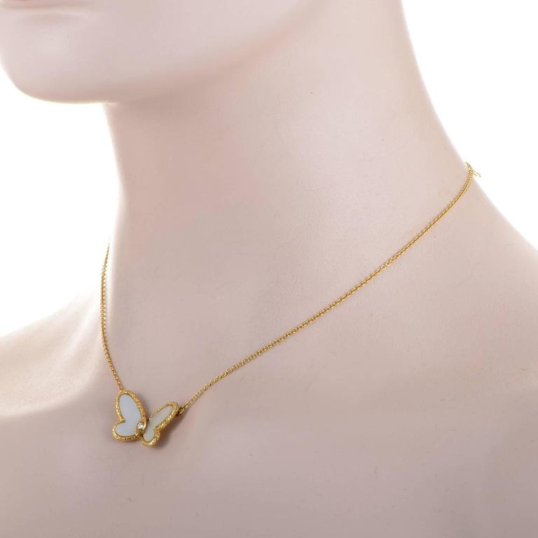 Van cleef and arpels mother of pearl gold butterfly necklace at 1stdibs opening its delightful mother of pearl wings to reveal a precious diamond the enchanting butterfly aloadofball Image collections