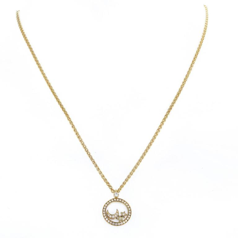 Chopard happy diamonds gold moon and stars pendant necklace at 1stdibs elevating their emblematic design feature to a whole new level chopard presents this spellbinding necklace aloadofball Images