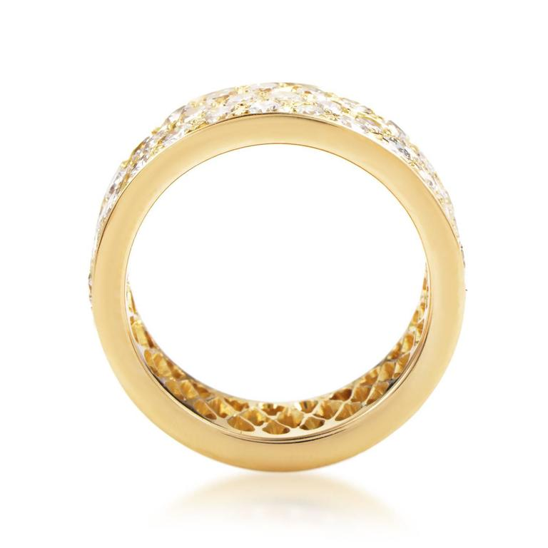 Where sophisticated prestige meets elegant simplicity, this magnificent wedding band from Van Cleef & Arpels boasts a neat 18K yellow gold body adorned with a brilliant arrangement of glistening diamonds weighing in total 2.93 carats. Included