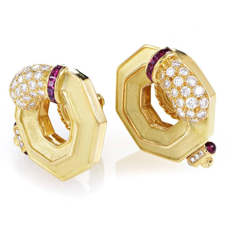An adorable design which tastefully combines diverse materials and nuances to produce a resolutely feminine overall tone, this exceptional pair of earrings from Chaumet boasts charming 18K yellow gold, lovely rubies totaling 0.40ct and lustrous