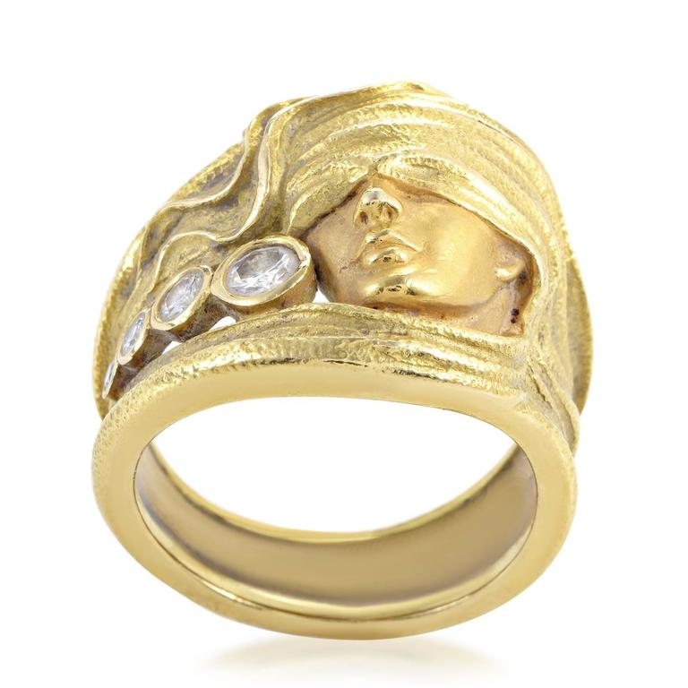 An engaging motif of a woman's face covered in wavering cloth crafted in astonishingly realistic fashion from precious 18K yellow gold makes this ring from Carrera y Carrera an item of immense artistic appeal embellished with 0.28ct of lovely