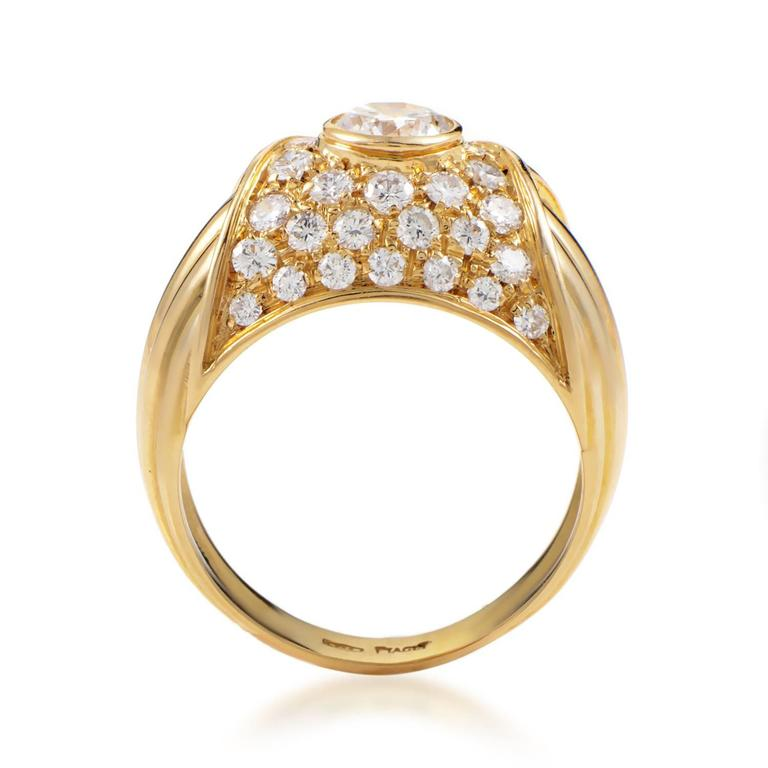 A sight of pure luxury and resplendent brilliance, this dazzling ring from Piaget employs the fabulous blend of radiant 18K yellow gold and majestically glistening diamonds weighing in total 1.85 carats to produce an eye-catching allure.