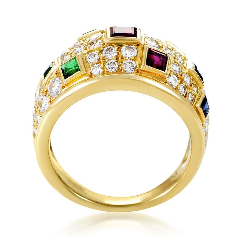 A rainbow of precious gemstones is the hallmark of this decadent ring from Piaget. The ring is made of 18K yellow gold and is paved with 1.35ct of diamonds. Lastly, dispersed throughout the design are colored gemstones including; .30ct of emeralds,