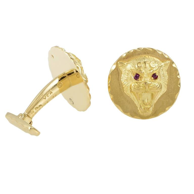 This pair of cufflinks from Van Cleef & Arpels are fiercely fashion-forward! They are made of 18K yellow gold and feature the depiction of a fearsome wildcat with glistening rubies for eyes. Included Items: Manufacturer's Pouch
