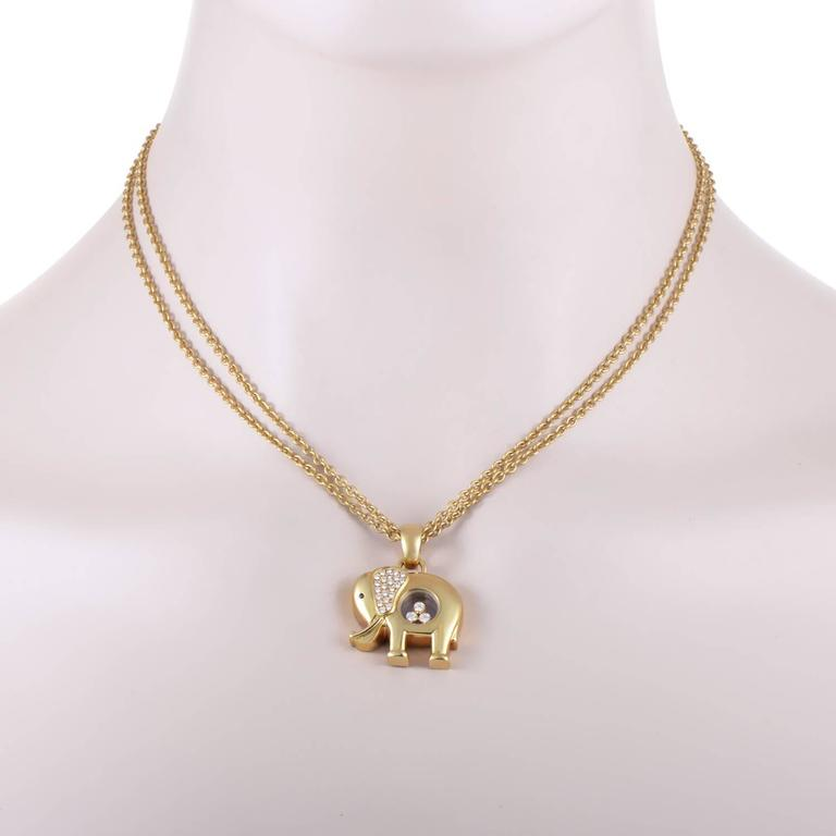 Chopard happy diamonds gold elephant pendant necklace at 1stdibs gold elephant pendant necklace for sale with the instantly recognizable feature of three engaging wandering diamonds and the ever charming form aloadofball Gallery