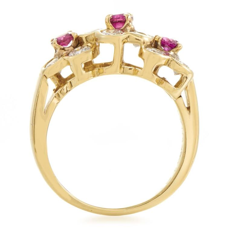 A precious blend of romantic rubies totaling 0.50ct and resplendent diamonds amounting to 0.70ct is arranged in a seemingly chaotic manner in this astonishing ring from Van Cleef & Arpels made of enchanting 18K yellow gold. Ring Size: 4.25 (47