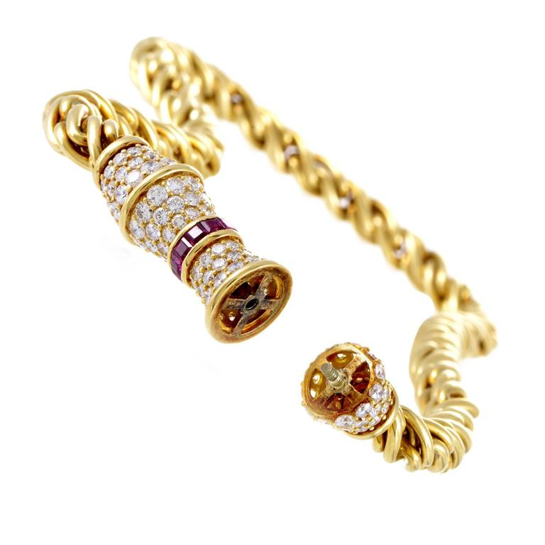 The fabulous pendant is lavishly embellished with F-color diamonds of VVS1 clarity weighing in total 9.00 carats as well as charming rubies totaling 1.50 carats in this spellbinding 18K yellow gold necklace from Hammerman Brothers that offers a
