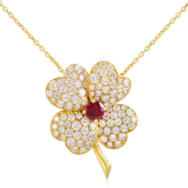Van cleef and arpels cosmos yellow gold diamond and ruby pendant boasting fabulous matching motifs and a glamorous overall tone this astonishing 18k yellow gold set mozeypictures Gallery