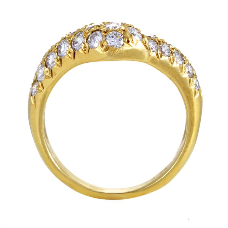 Boasting a wonderfully crooked shape made of enchantingly radiant 18K yellow gold and embellished with a neat arrangement of scintillating F-color diamonds of VVS clarity that weigh in total approximately 1.20 carats, this is a classically appealing