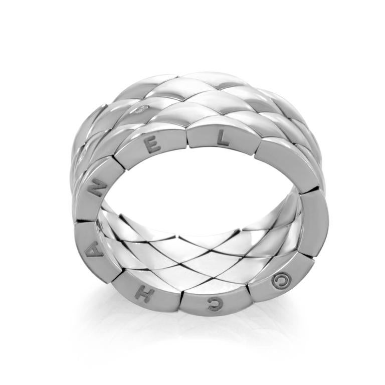 Striking lines slice through the immaculately gleaming 18K white gold surface to create the magnificent diamond pattern in this sublime ring from Cartier 