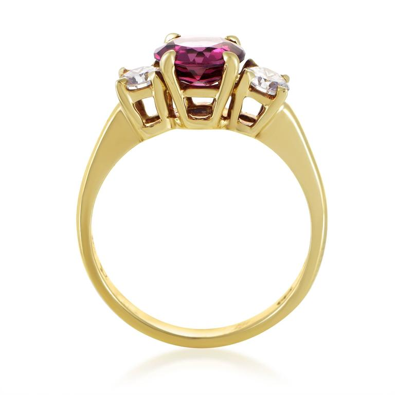 Exuding its romantic nuance and exhibiting its exceptional cut upon a marvelously designed and impeccably crafted 18K yellow gold body of this stunning ring from Tiffany & Co, the enchanting tourmaline weighing approximately 1.50ct is joined by