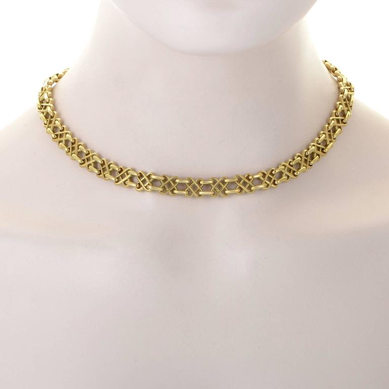 Magnificent elegance and fabulous radiance captivate at the very first sight while the amazingly intricate design and exquisite craftsmanship are revealed upon a closer look at this remarkable 18K yellow gold necklace from Tiffany & Co. Included
