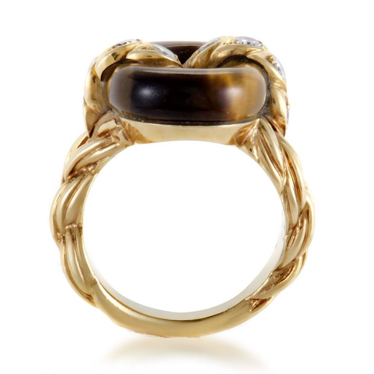 Exquisitely ornamented 18K yellow gold, expertly set diamonds weighing in total 0.48ct and remarkably shaped tiger eye stone create a magnificent appearance in this sublime vintage ring from Van Cleef & Arpels. Included Items: Manufacturer's