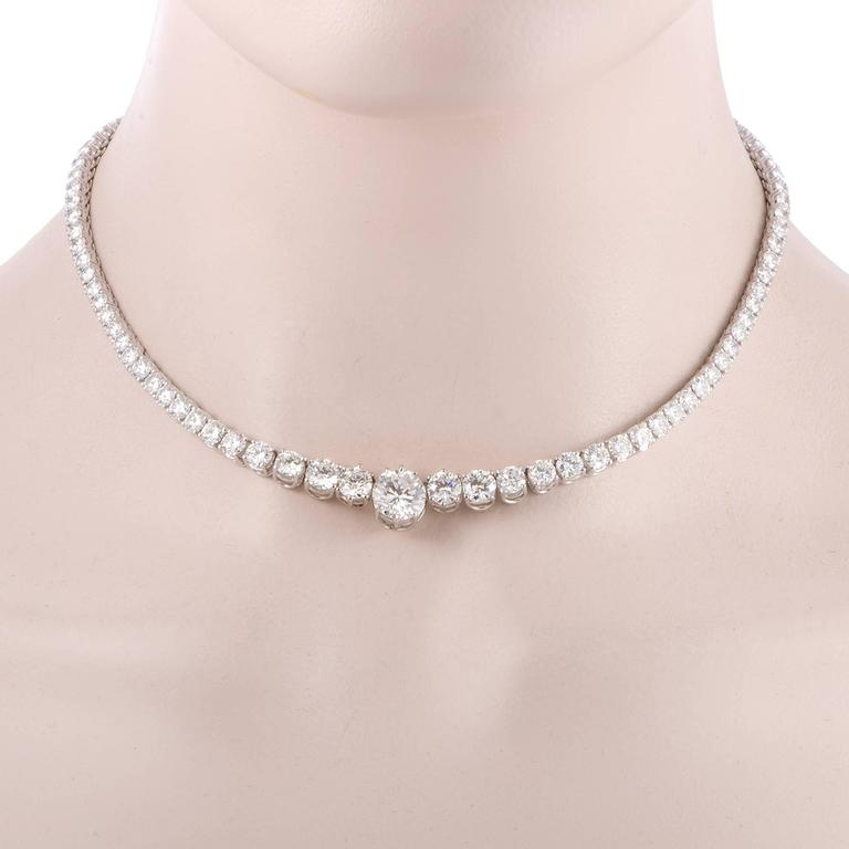 Lined with expertly cut and marvelously lustrous diamonds weighing in total 20.50 carats, this magnificent necklace is made of shimmering 18K white gold and boasts a majestic central F-color diamond of VVS1 clarity weighing 3.08 carats for a