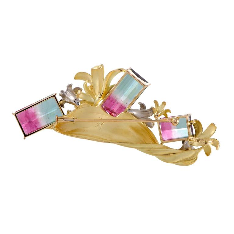 The luxurious blend of fabulous 18K yellow gold and gleaming platinum welcomes charming diamonds totaling 0.22ct as well as stunning watermelon tourmalines amounting to 27.09 carats in this gorgeously designed and expertly designed brooch.