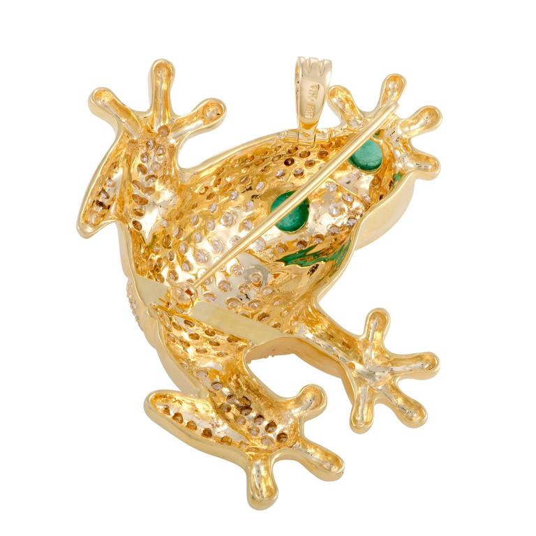An adorable motif presented in a glamorously luxurious setting, the marvelous shape of a frog is comprised of precious 18K yellow gold and glittering diamonds weighing in total approximately 5.80 carats in this enchanting brooch.