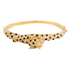 Diamond Ruby and Onyx Yellow Gold Bangle Bracelet