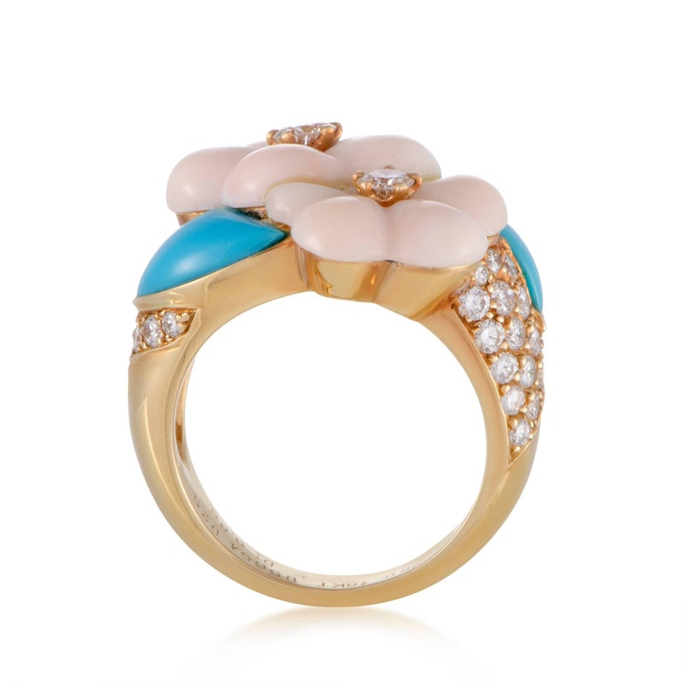 Designed in the brand's distinctive manner of employing gentle colors to brilliantly depict nature, this flower-inspired ring from Van Cleef & Arpels is made of radiant 18K yellow gold with lovely turquoise and coral stones as well as sparkling