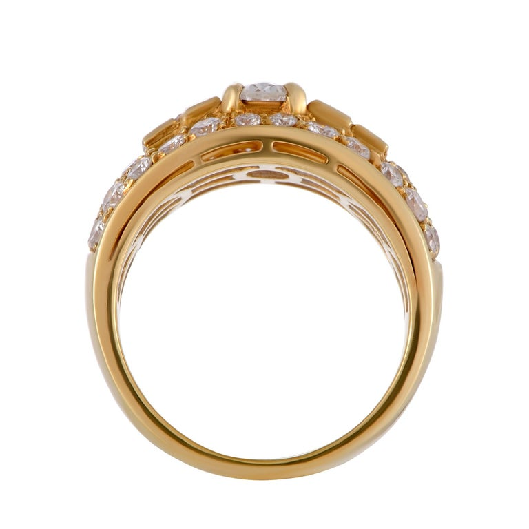 Incredibly refined and opulent at the same time, this stunning ring designed by Bvlgari is made of enchanting 18K yellow gold and embellished with an array of spectacular diamond stones, with the one at the center weighing approximately 0.60 carats