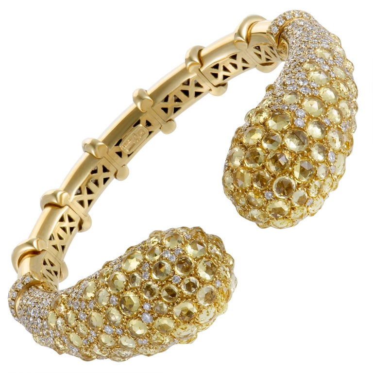An absolutely majestic statement piece, this Mikimoto bracelet is made of luxurious 18K yellow gold and set with a lavish blend of diamonds and yellow sapphires. The diamonds total 7.45 carats and the sapphires 28.76 carats.