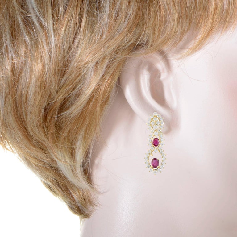 These spectacular 18K yellow gold earrings perfectly epitomize beauty and style. The fabulous earrings are embellished in a sparkling 2.30ct of diamonds and two gorgeous rubies that way a carat each. These decadent earrings will enhance the