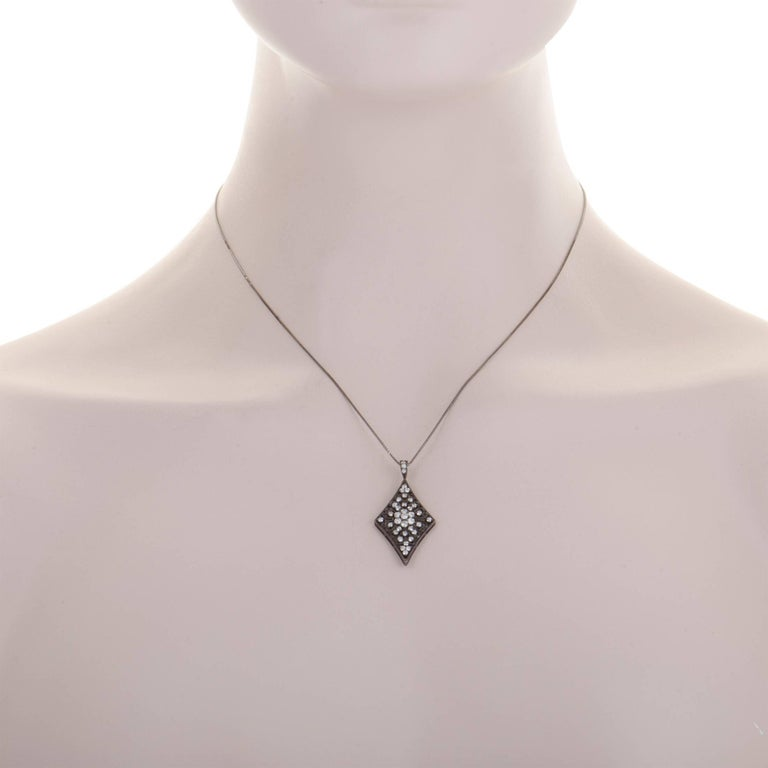 Plated with black rhodium, this 18K white gold necklace offers an incredibly eye-catching, offbeat appearance. The pendant features nifty intricate décor and it is set with scintillating diamonds that weigh in total 0.70 carats. Pendant Dimensions: