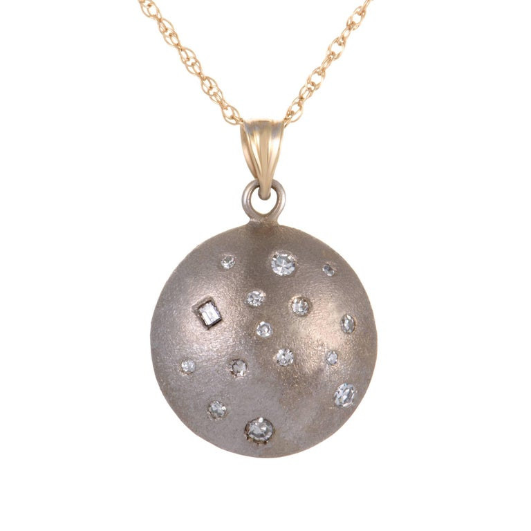 Featuring a pendant that can be worn on both sides, this extraordinary necklace offers both an elegantly gleaming look, as well as a slightly subdued, understated rhodium-accented one. The necklace is made of 18K yellow gold and boasts a total of