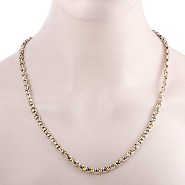 Featuring the renowned Bulgari design, this stunning men's necklace boasts an incredibly offbeat, masculine appeal. Made of 18K yellow and white gold, the necklace has a length of 22 inches and weighs 62 grams. Included Items: Manufacturer's Pouch