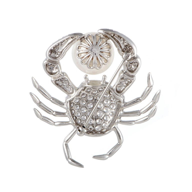 Symbolizing wonderfully the treasures of the sea world with its extraordinary design and luxurious décor, this splendid brooch from Tiffany & Co. is an item of immense aesthetic value. Depicting a crab, the brooch is made of prestigious platinum and