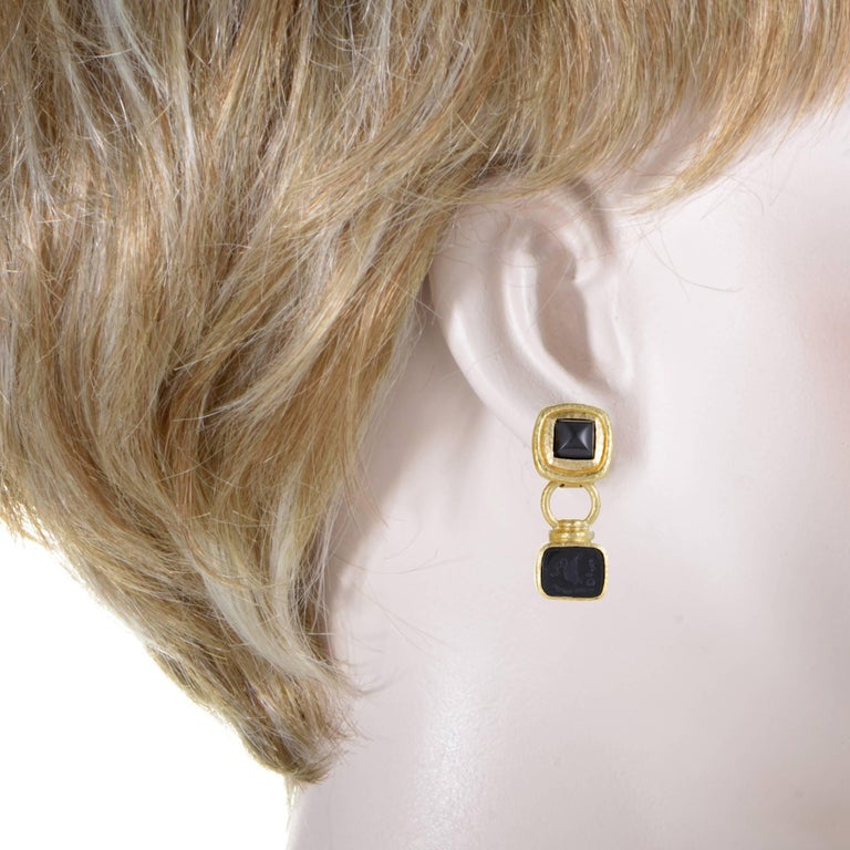 These superb earrings are designed by Elizabeth Locke and feature bold, eye-catching appearance with a distinct fashionable appeal. The pair is made of prestigious 19K gold and embellished with striking onyx stones.